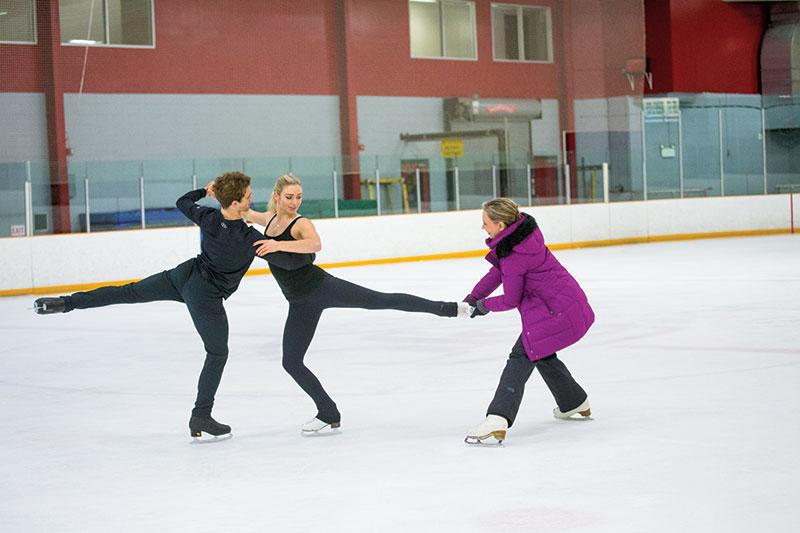 Elana Novak coaching Rachel and Michael Parsons.